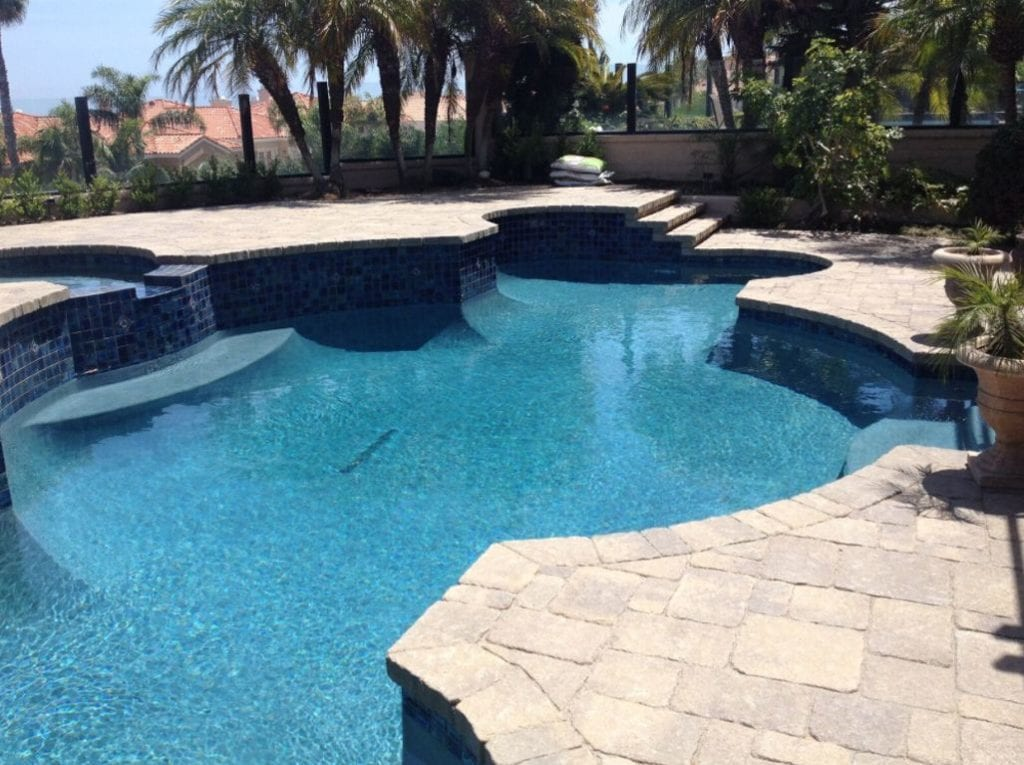 white limestone around pool