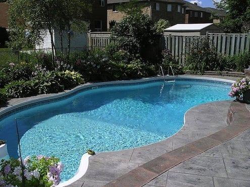 grey stone around pool