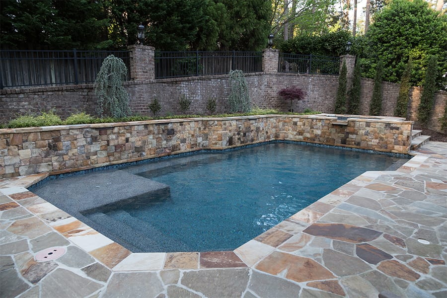 multi colored stone work around pool