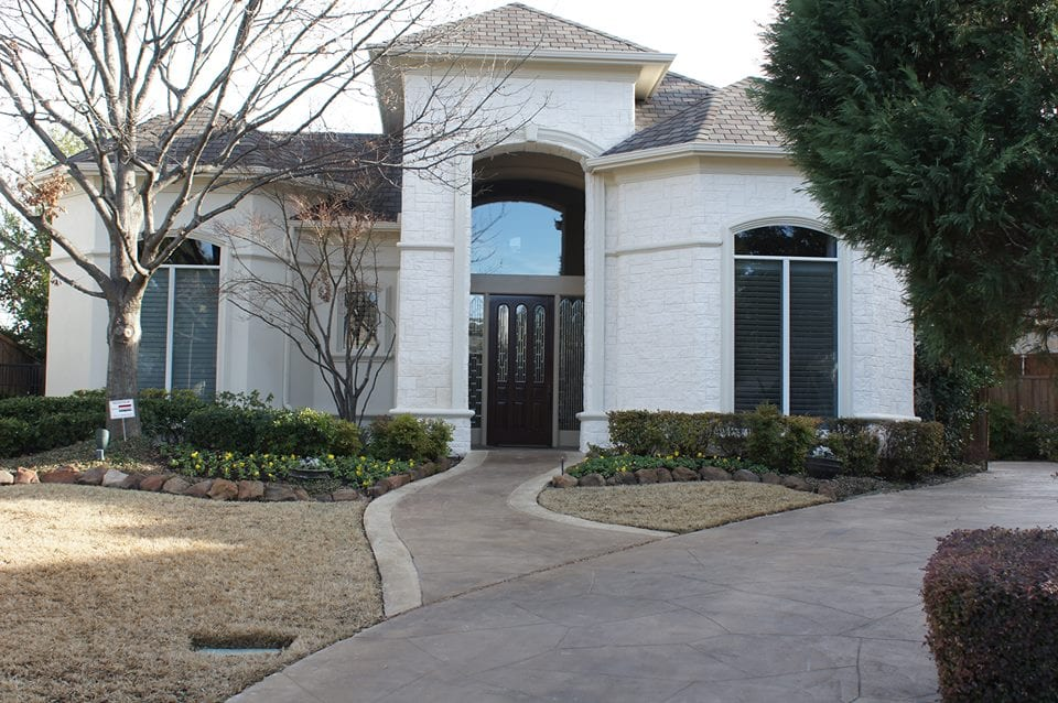 white limestone exterior remodel