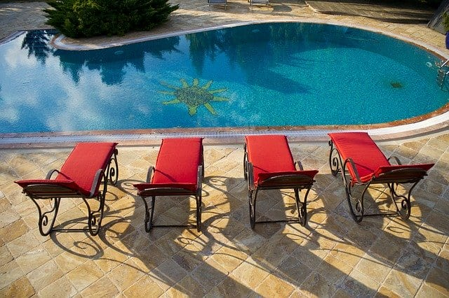 four lounge chairs pool side