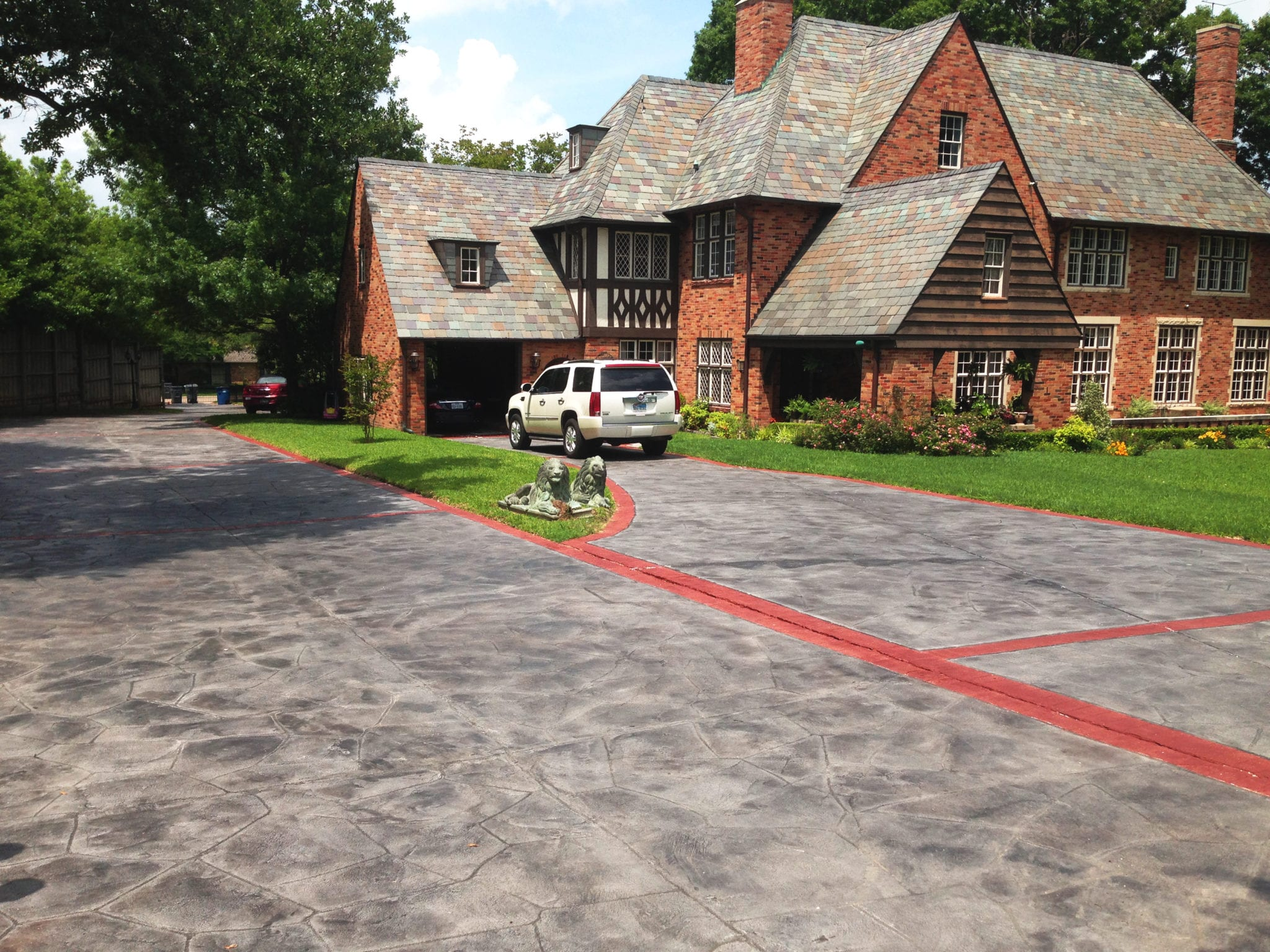 Big Driveway with grey stone resurfacing