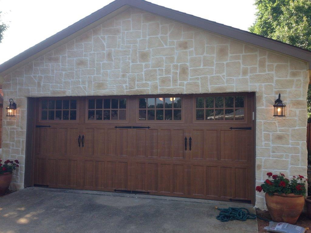 wooden garage door stone remodel