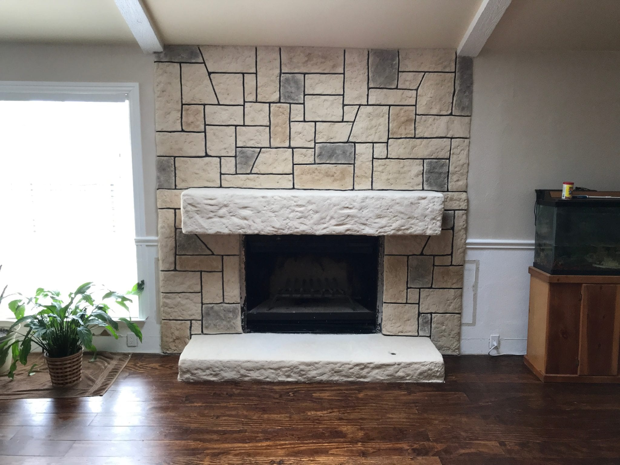stone fireplace etched and remodeled