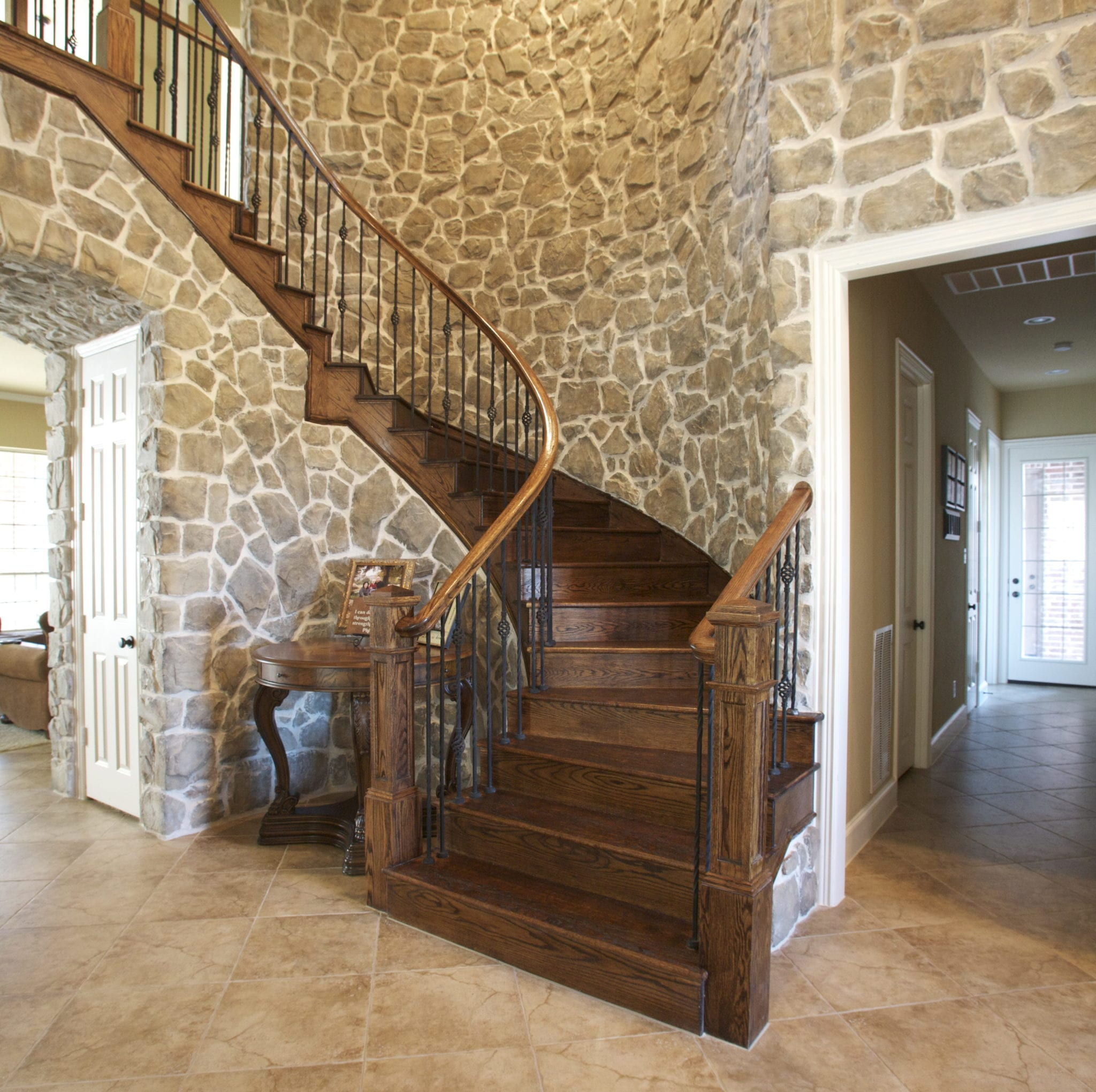 half spiral staircase with remodeled stone around