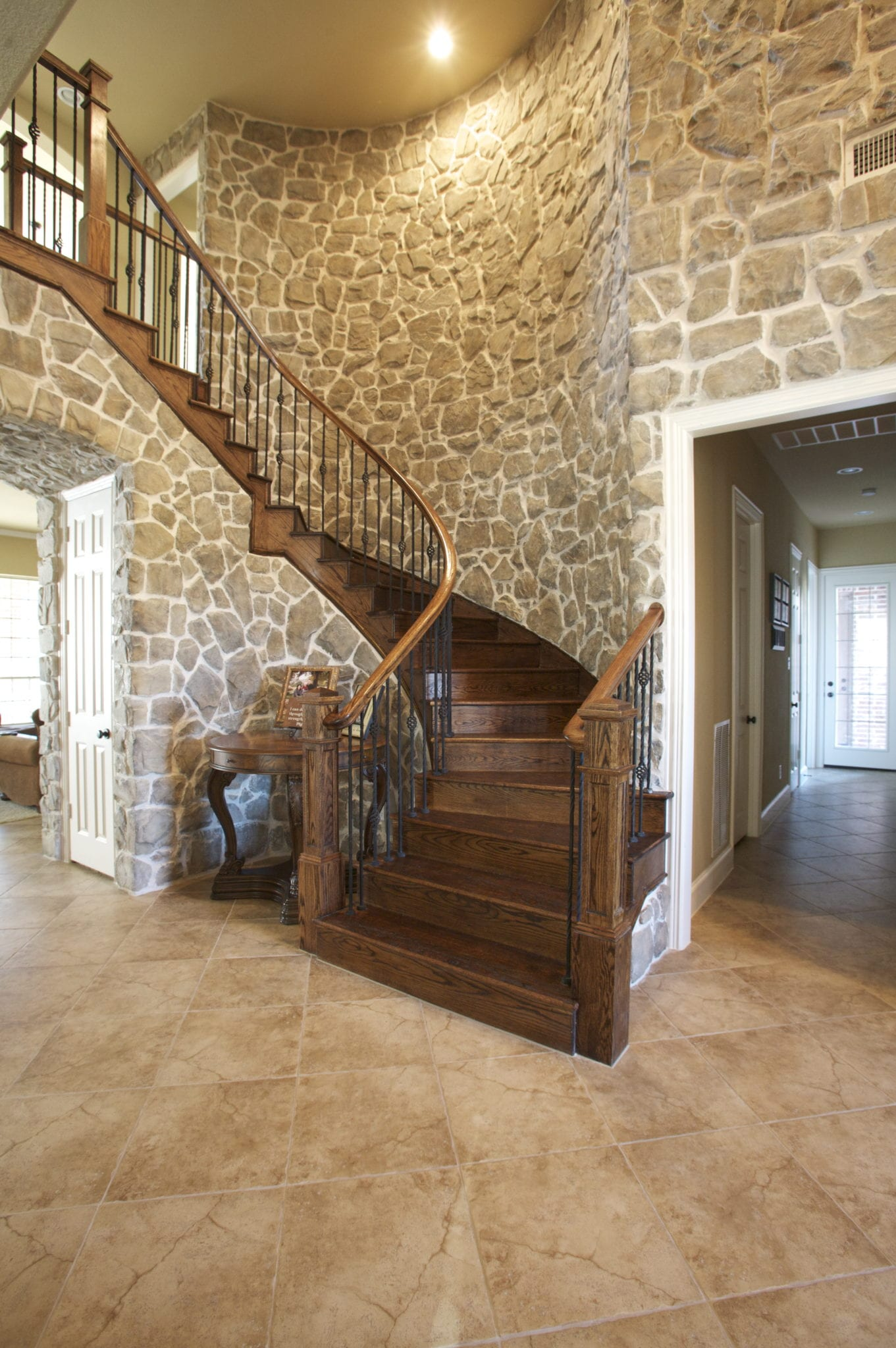 staircase with stone accents