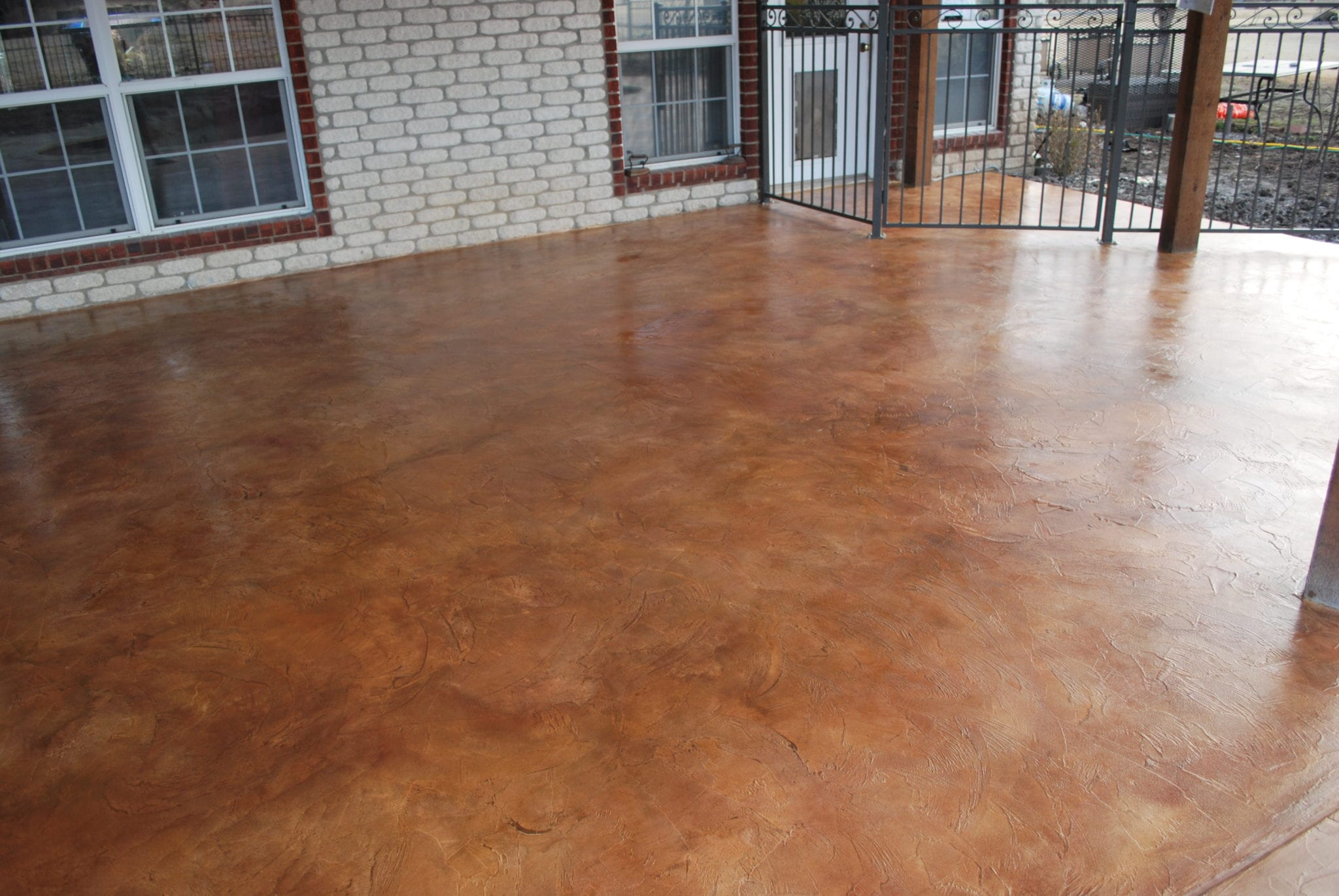 brown red pool deck resurfaced