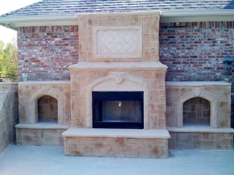 outside fireplace with side fireplaces