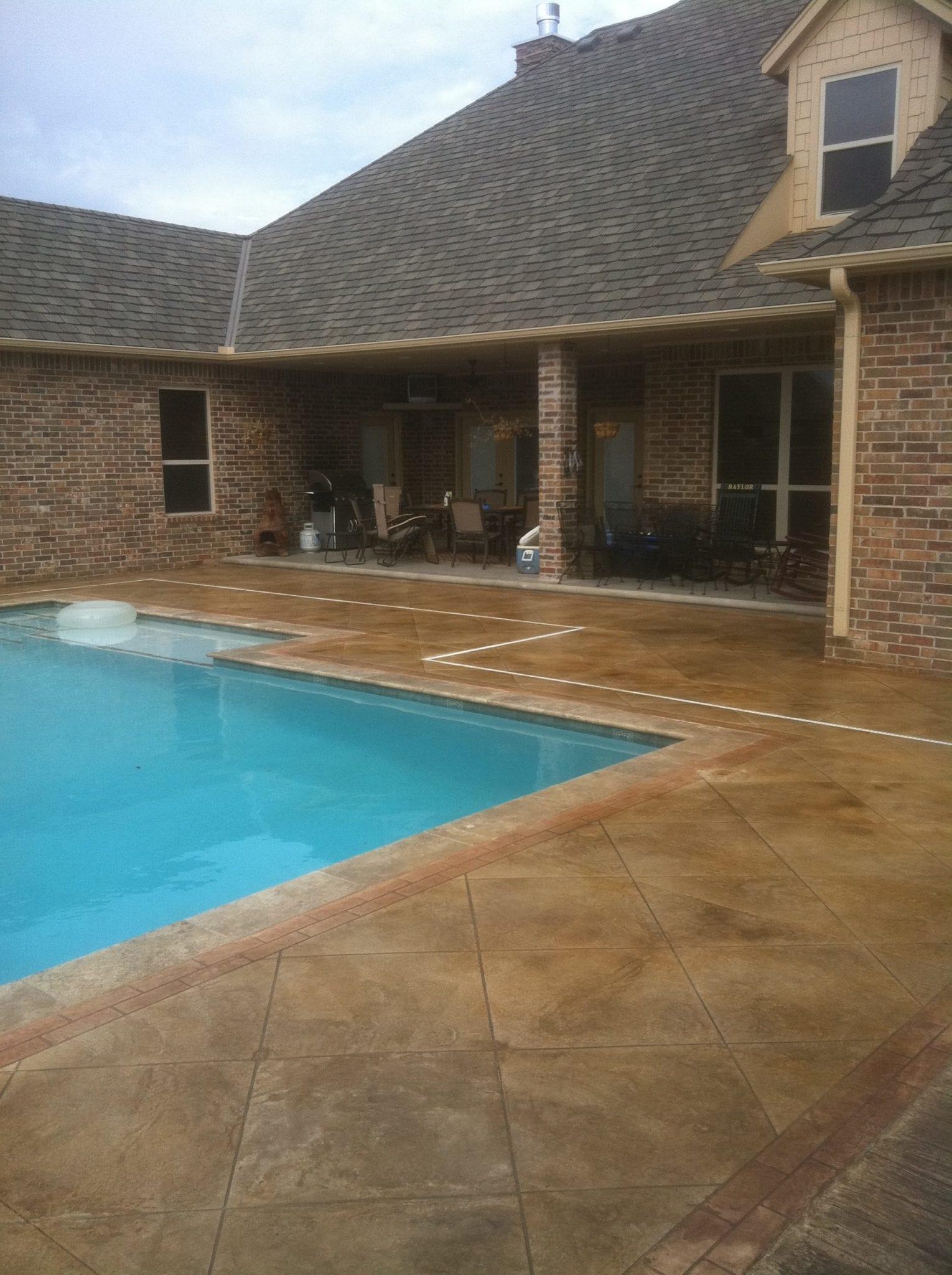 wet stone outside around pool