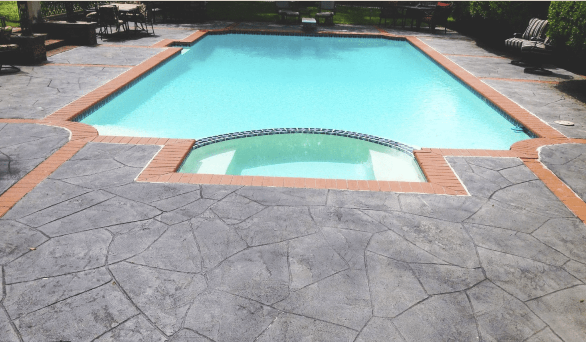 grey stone poolside remodel